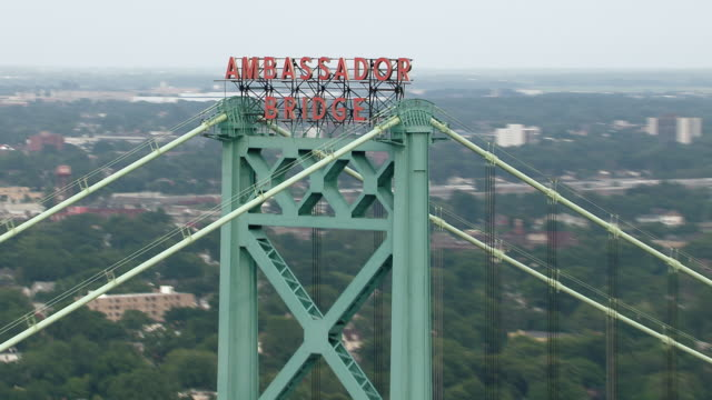 The Ambassador Bridge, a suspension bridge built in the late 1920's which spans the Detroit River, creating an international border crossing from Detroit, Michigan in the US to Windsor, Ontario in Canada.
