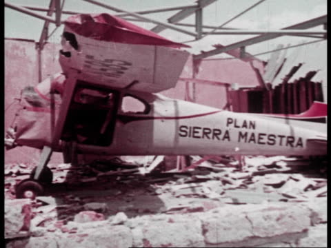 the american bombed airfields of santiago with destroyed planes - agricultural cooperative stock videos and b-roll footage