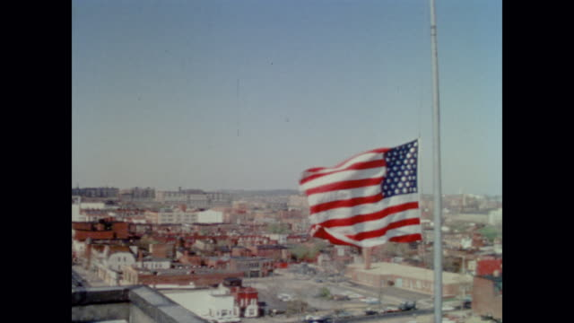 the american flag at half mast ripples brightly in the breeze above washington dc - assassination stock videos & royalty-free footage