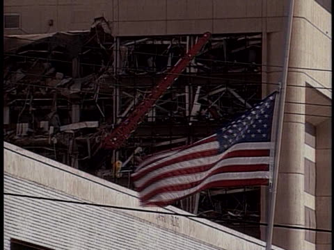 the american flag flies at half-mast near the bombed murrah federal building in oklahoma city. - oklahoma city bombing stock videos & royalty-free footage