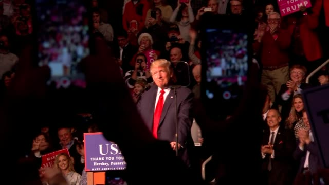 vídeos de stock e filmes b-roll de the amish and donald trump obscured shot of trump at podium as chants of 'usa' heard sot - amish