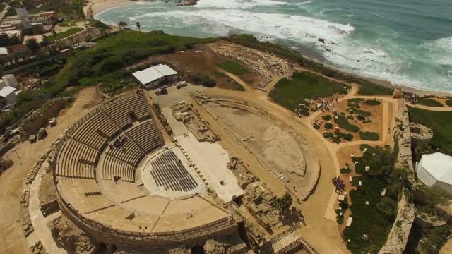 vídeos y material grabado en eventos de stock de the amphitheatre built by herod the great, ancient caesarea, israel - anfiteatro
