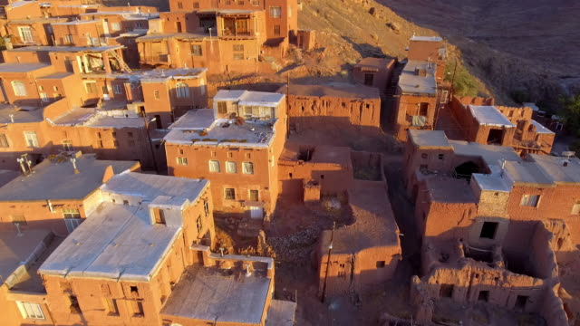 the ancient iranian village abyaneh at sunrise from above. - david ewing stock-videos und b-roll-filmmaterial