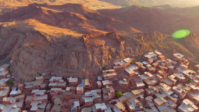 the ancient iranian village abyaneh at sunrise from above. - david ewing stock videos & royalty-free footage