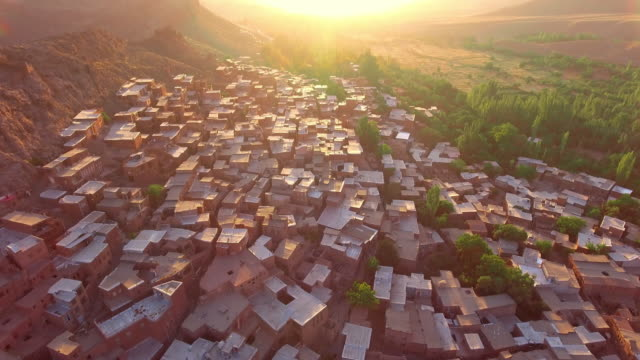 The ancient Iranian village Abyaneh at sunrise from above.