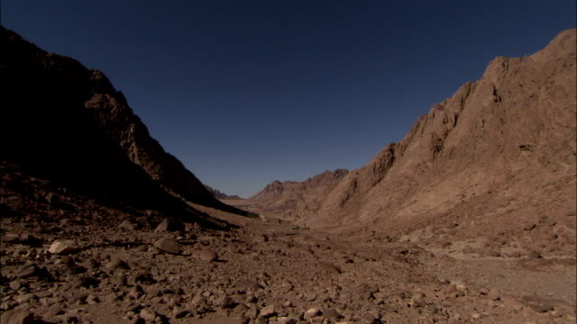 the ancient saint catherine's monastery sits nestled in a barren rocky gorge in mount sinai egypt. available in hd. - sinai egitto video stock e b–roll