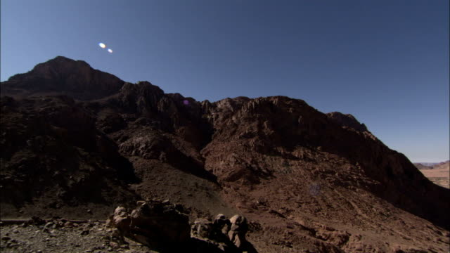 The ancient Saint Catherine's Monastery sits nestled in a rocky gorge in Mount Sinai Egypt. Available in HD.