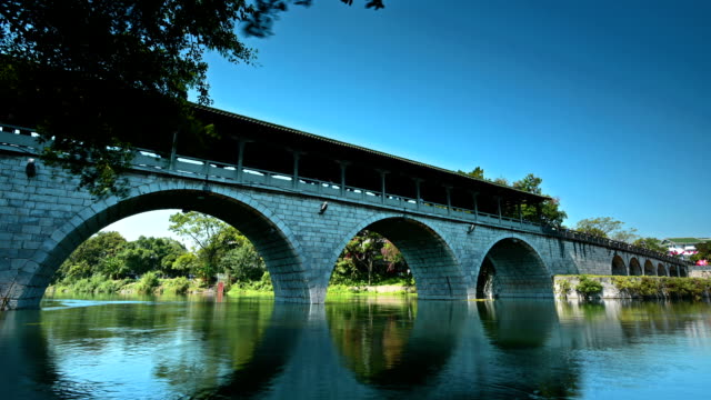 the ancient stone arch bridge - bridge built structure stock videos & royalty-free footage