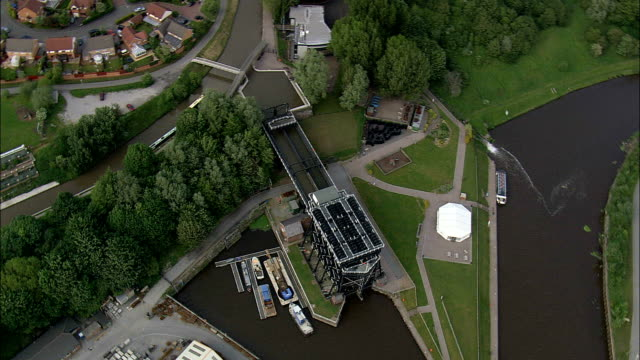 the anderton lift  - aerial view - england,  cheshire,  anderton with marbury helicopter filming,  aerial video,  cineflex,  establishing shot,  united kingdom - cheshire england stock videos & royalty-free footage
