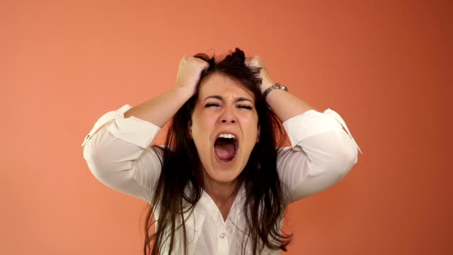 the angry woman yells and wipes hair,super slow motion - damaged stock videos & royalty-free footage