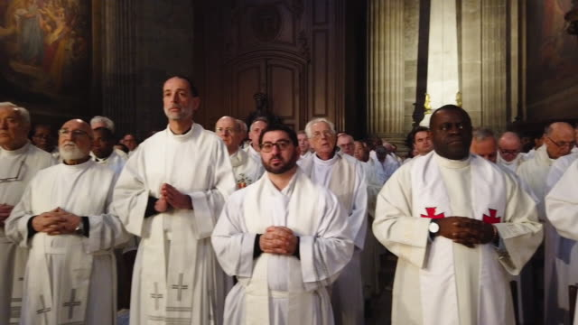 the annual chrism mass is held in the wake of a major fire that damaged the iconic notre dame cathedral, on monday, at saint-sulpice church on april... - ミサ点の映像素材/bロール