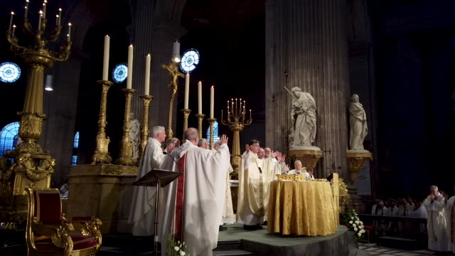 the annual chrism mass is held in the wake of a major fire that damaged the iconic notre dame cathedral on monday at saintsulpice church on april 17... - messen stock-videos und b-roll-filmmaterial