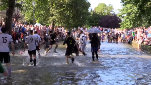 the annual football in the river match takes place in the river windrush in bourton on the water gloucestershire on august bank holiday the match is... - windrush river stock videos and b-roll footage