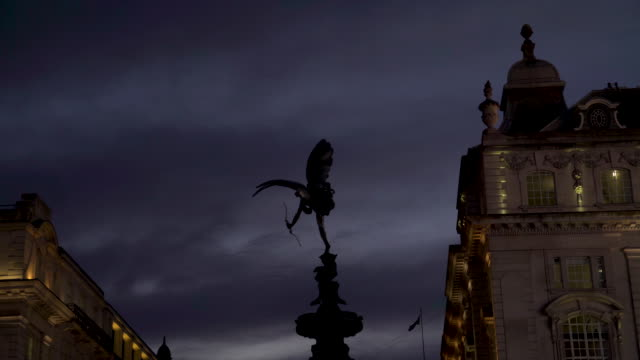the anteros sculpture atop the shaftesbury memorial, piccadilly circus, against a cloudy night sky - greek mythology stock videos and b-roll footage