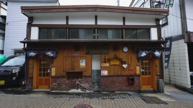 the appearance of the fifth hot spring (gobanyu) called matsunoyu along the alley at shibu onsen (shibu hot spring) yamanouchi, yudanaka nagano japan on feb. 20 2019. - joshinetsu kogen national park stock videos and b-roll footage