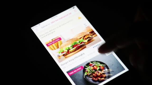 the application icon for foodpanda a mealdelivery service operated by delivery hero ag is displayed on a smartphone in an arranged video taken in... - guter zustand stock-videos und b-roll-filmmaterial