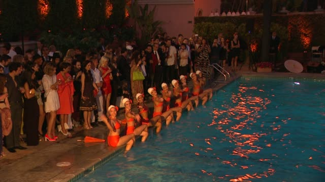 the aqualillies at cointreau and dita von teese launch cointreau poolside soirees in celebration of the beverly hills hotel's 100th anniversary in... - beverly hills hotel stock videos and b-roll footage