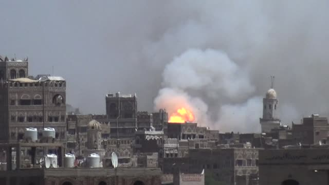 the arab coalition led by saudi arabia continued pounding huthi rebel positions in yemen's capital on thursday, with airstrikes targeting the al-hafa... - air raid stock videos & royalty-free footage