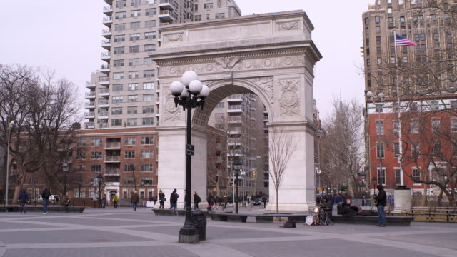 the arch in washington square park with a jazz duo beneath it - washington square park stock videos and b-roll footage