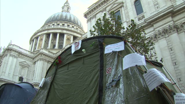 The Archbishop of Canterbury has lent his support to the demonstrators outside St Paul's cathedral by calling for a multibillion pound tax on...