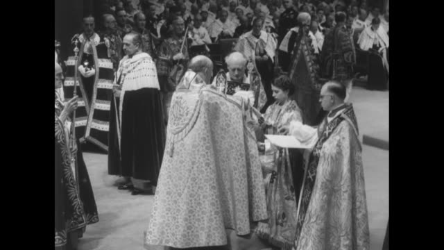 the archbishop of canterbury presents elizabeth with the sceptre with the cross and the rod with the dove elizabeth seated on king edward's chair... - coronation stock videos and b-roll footage