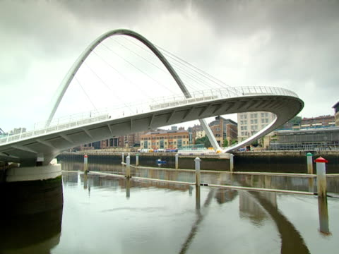 the arches of the gateshead millennium bridge reflect on the river tyne. - tyne and wear stock videos & royalty-free footage