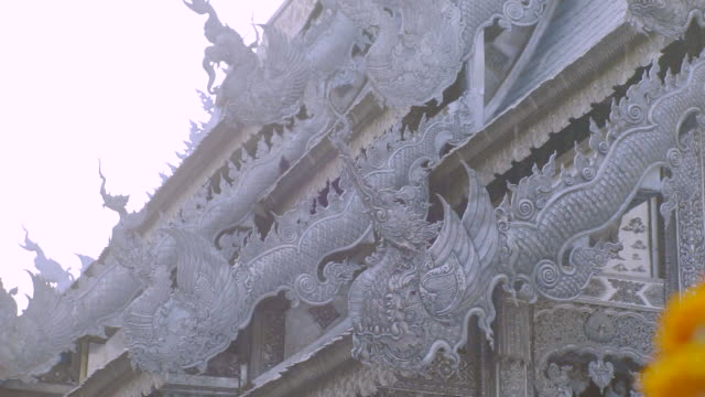 the architecture roof of the silver temple is covered from the walls to the roof with silver in chiang mai. - chiang mai province stock videos & royalty-free footage