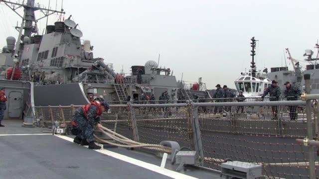 the arliegh burke-class guided-missile destroyer uss fitzgerald departs yokosuka, japan on an independent patrol - 軍事基地点の映像素材/bロール