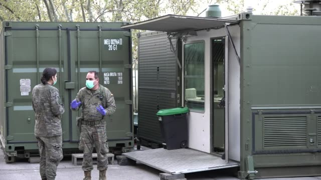 the army and the emergency medical unit , dependent on the ministry of defense, have settled in barcelona and in other spanish cities to collaborate... - army video stock e b–roll