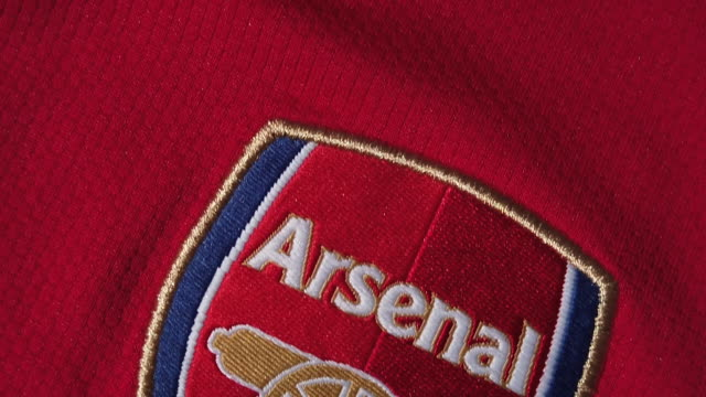 the arsenal club crest on their home shirt on may 28, 2020 in manchester, england. - cannon stock videos & royalty-free footage