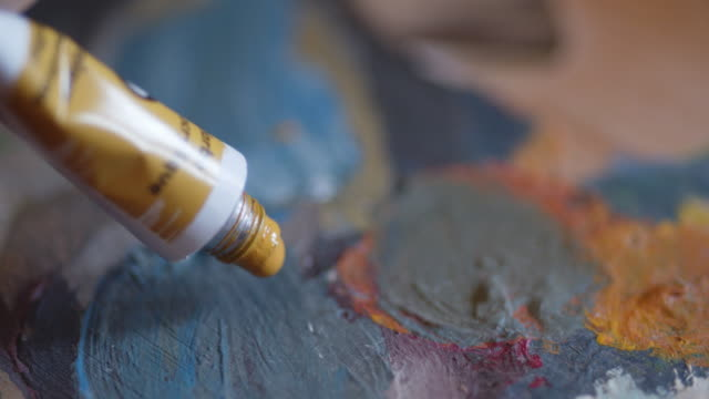 the art of painting. an active senior woman with her hobbies. handmade painting, working space, handcraft, artwork, ideas, close up - craft stock videos & royalty-free footage