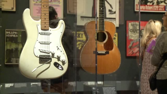 vídeos de stock, filmes e b-roll de the art of rock and roll gets its due at the latest exhibit at new york's met museum, which has decked its halls with more than 130 iconic... - rock moderno
