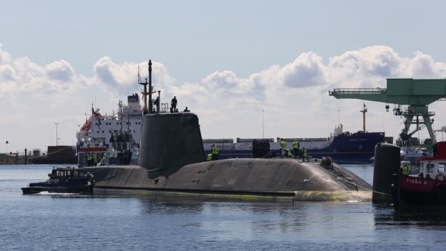 the artful an astute class hunter killer nuclear powered submarine is moved from bae systems in barrow in furness up to the faslane submarine base in... - nuclear missile launch stock videos & royalty-free footage