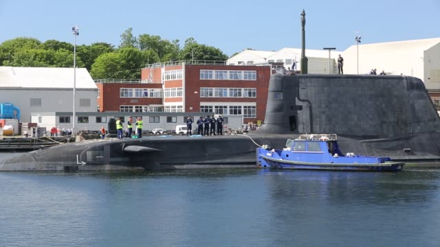 the artful an astute class hunter killer nuclear powered submarine is moved from bae systems in barrow in furness up to the faslane submarine base in... - torpedo stock videos & royalty-free footage