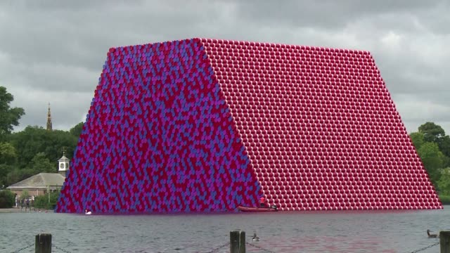 the artist christo unveiled a giant sculpture in the middle of hyde park's serpentine lake on monday - the serpentine london stock videos & royalty-free footage