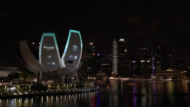 the artscience museum in singapore joins in efforts to highlight climate change by running family events and going dark for earth hour - earth hour stock videos & royalty-free footage