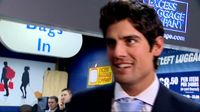Alastair Cook returns home ENGLAND London Heathrow Airport PHOTOGRAPHY** Alastair Cook along through airport terminal as surrounded by photographers...