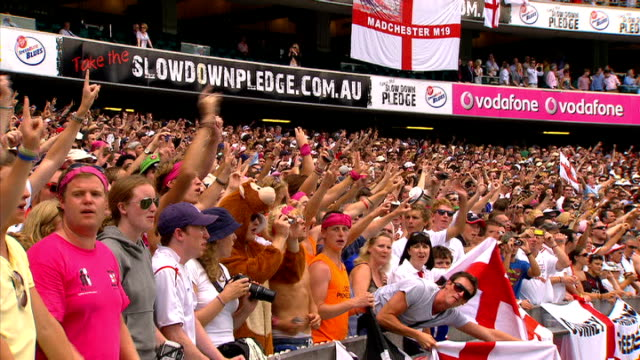 england win fifth test and ashes series; barmy army chanting and holding hands up in victory salute fan wearing queen mask waving and holding hands... - fan enthusiast stock videos & royalty-free footage