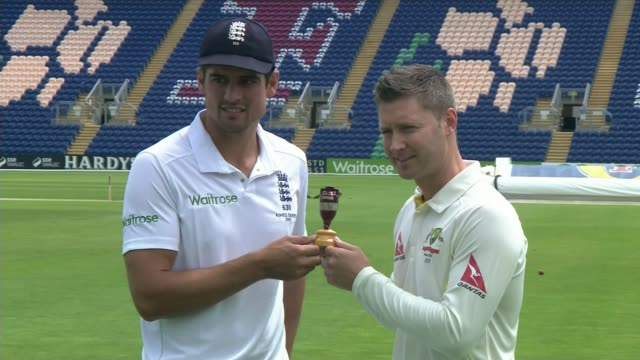 england win fourth test and regain the ashes; t07071513 / tx wales: cardiff: alastair cook and michael clarke posing for photocall with ashes - ashes test stock videos & royalty-free footage