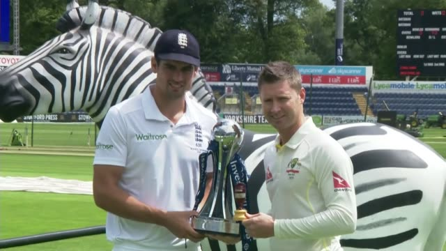 the ashes 2015 preview; wales: cardiff: ext alastair cook holding ashes trophy behind back tilt up cook and australian cricket captain michael clarke... - ashes test stock videos & royalty-free footage