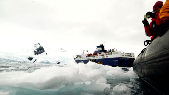the assault boat patrolled on wilhemina bay - antarctica stock videos & royalty-free footage