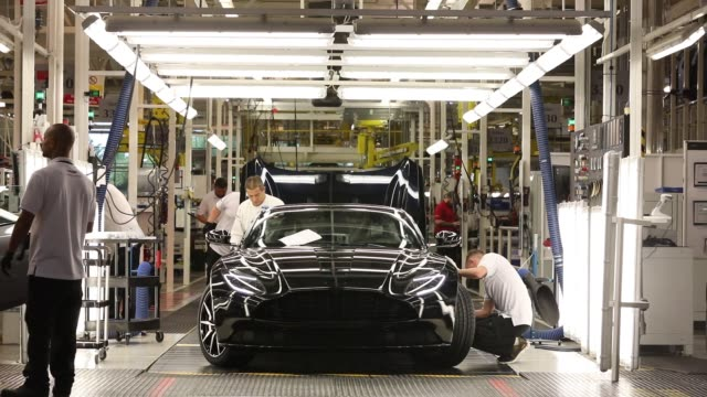the aston martin db11 luxury automobile's paint job is inspected at the aston martin lagonda ltd's manufacturing and assembly plant in gaydon uk on... - quality control stock videos and b-roll footage