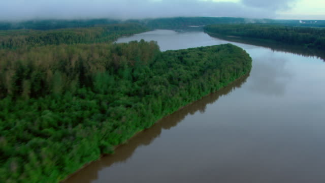 The Athabasca River winds through the boreal forest near Fort McMurray, Canada.