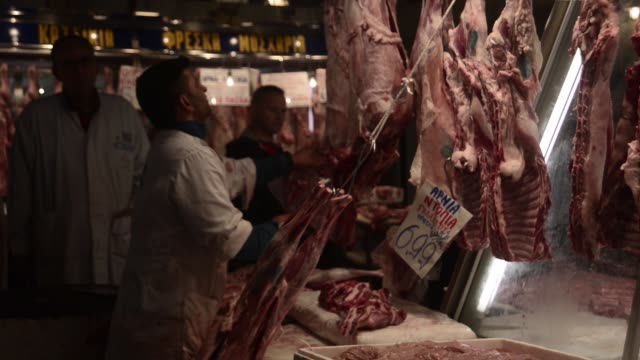 ws the athens central market know as varvakos agora has been a center of athenian life for more than a hundred years in the meat market long tubes of... - run over stock videos & royalty-free footage