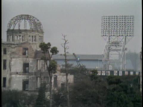 the atomic dome rises above the peace park in hiroshima. - (war or terrorism or election or government or illness or news event or speech or politics or politician or conflict or military or extreme weather or business or economy) and not usa点の映像素材/bロール