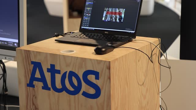 the atos logo next to a laptop before a press conference at atos technology days 2021 on july 2 in bezons, france. at its annual atos technology days... - big data stock videos & royalty-free footage