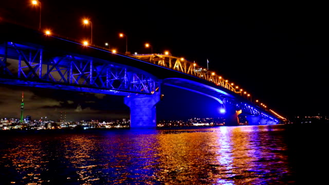 the auckland harbour bridge is pictured lit up with christmas lights on december 15, 2018 in auckland, new zealand. vector lights is counting down... - new zealand culture stock videos & royalty-free footage
