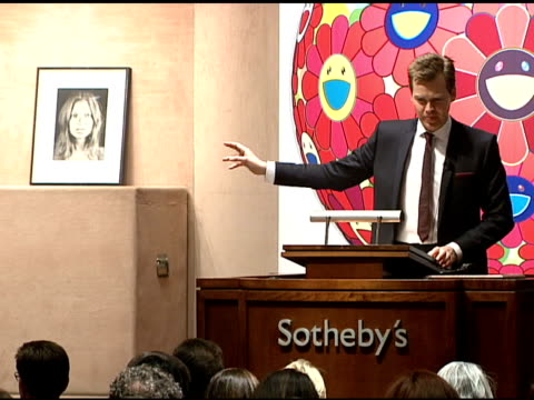 the auction at the bono and damien hirst paint the town red for aids in africa the auction at sotheby's in new york new york on february 14 2008 - sotheby's stock videos and b-roll footage