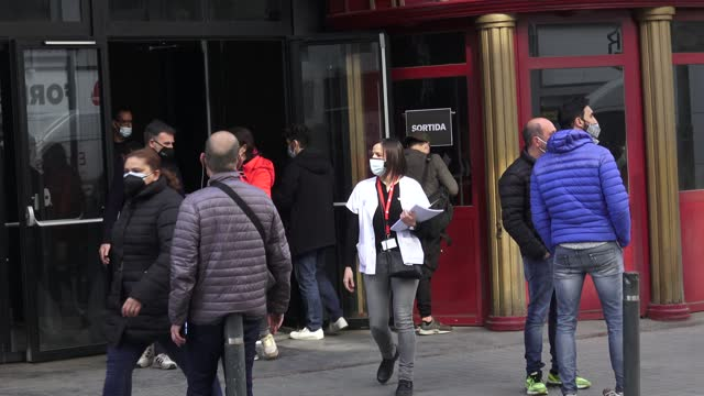 vidéos et rushes de the audience is seen leaving the building after to get tested for covid-19 with an antigen test before attending a concert of love of lesbian music... - audience de festival