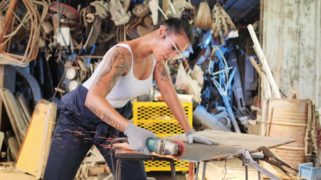 the auto mechanic and car spray is a woman with tattoos on the body. - wrench stock videos & royalty-free footage